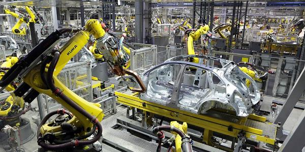 Industrial robots manufacture the bodywork of a new Porsche in Leipzig
