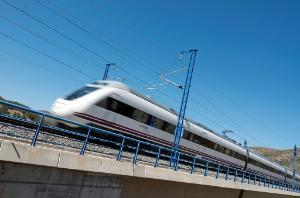 View of a high-speed train crossing a viaduct in Bubierca, Spain