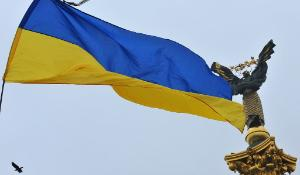 A Ukrainian flag flutters over Independence square