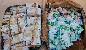 A suitcase full of seized money during a press conference of the Dutch and Antwerp judici
