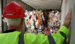 File photo dated 22/09/09 of an Environment Agency worker inspecting a shipping container filled with refuse.  ©BELGA_PRESSASSOCIATION
