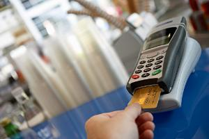 Customer placing bank card in credit card reader
