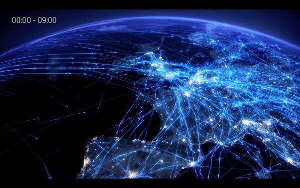 La Terre vue de l'espace, avec des lignes illuminées représentant les vols des avions