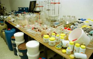 The display on a table top represents one of Europe's biggest illegal synthetic drugs laboratories
