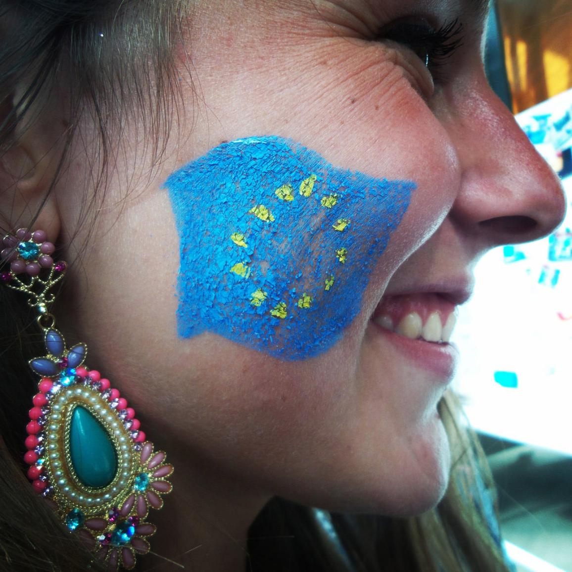 A young girl with the EU flag painted on her cheek at the EYE event in Strasbourg
