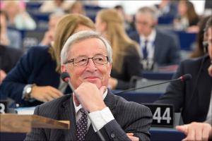 Jean-Claude Juncker smiles during the debate