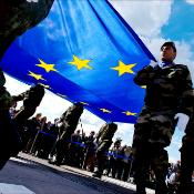 9. Soldiers carrying the EU flag