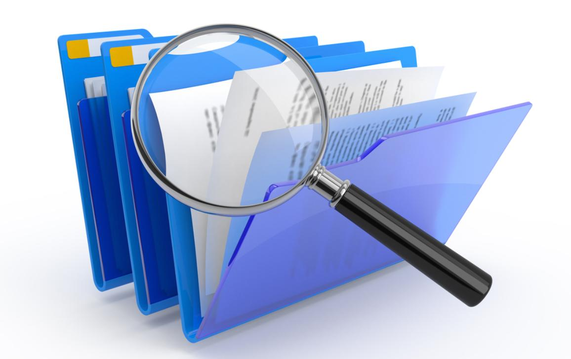 Magnifying glass on documents