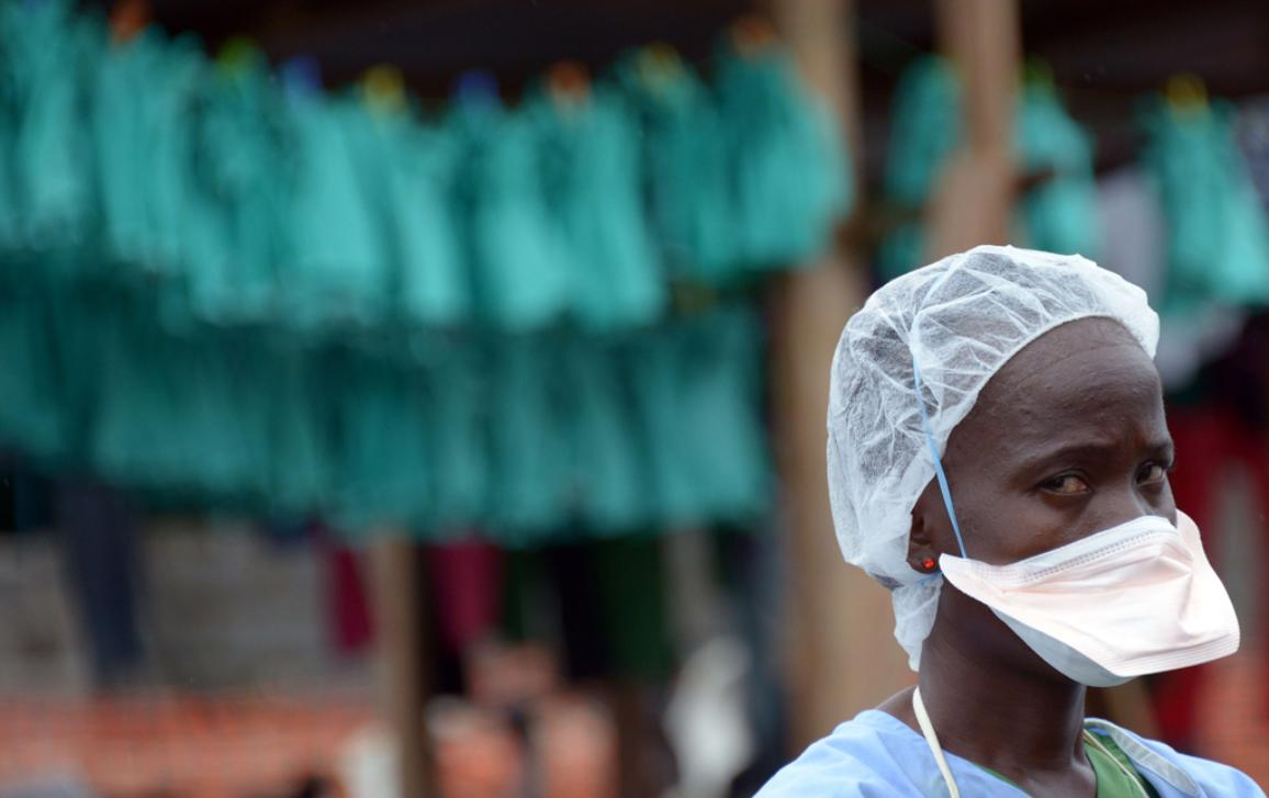Health care worker in front of an hospital in Liberia