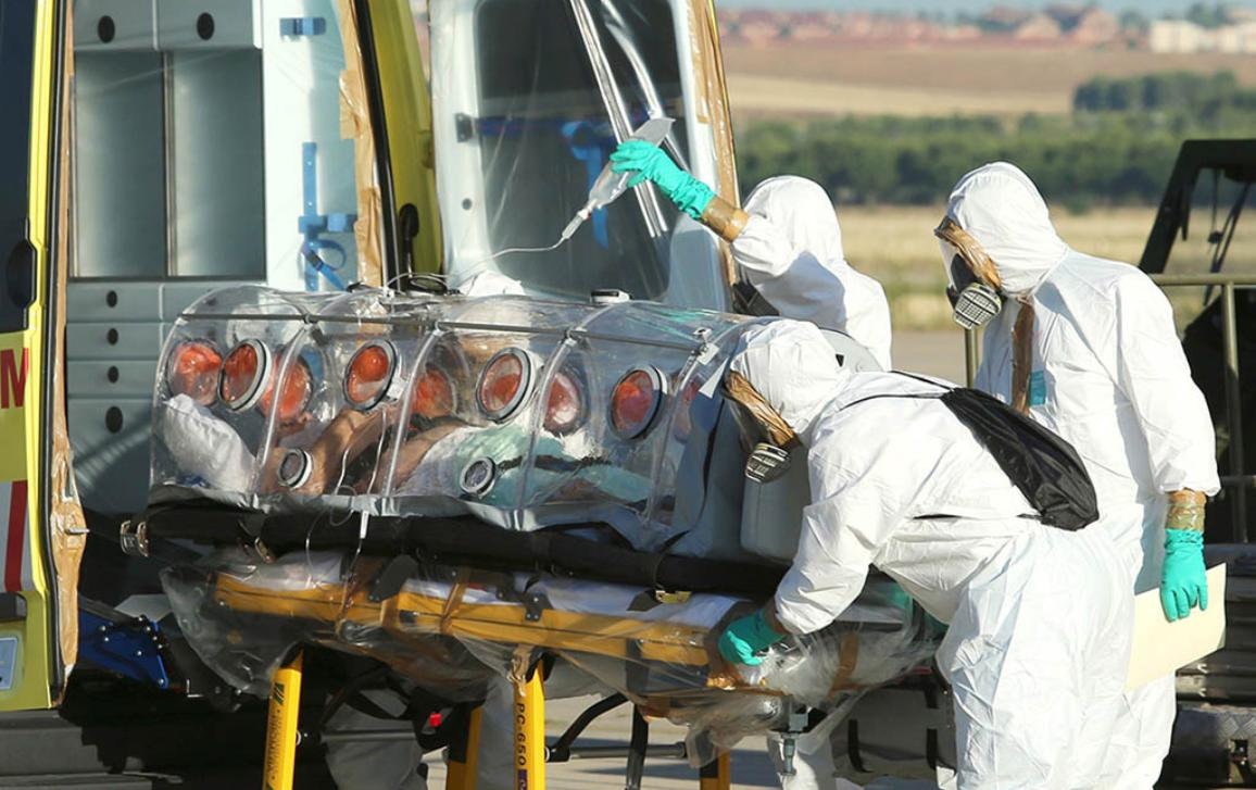 A file handout picture taken and released on August 7, 2014 by the Spanish Defense Ministry shows Roman Catholic priest Miguel Pajares, who contracted the deadly Ebola virus, being transported from Madrid's Torrejon air base to the Carlos III hospital upon his arrival in Spain. The Carlos III hospital announced on August 12, 2014 that the evacuated Spanish priest Miguel Pajares has died. ©BELGA/AFP PHOTO/SPANISH DEFENSE MINISTRY/INAKI GOMEZ