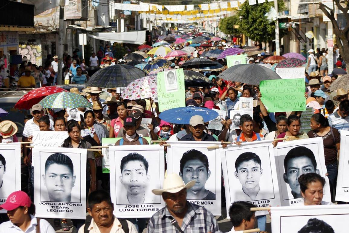 Relatives and peers of the 43 missing students of Normal School of Ayotzinapa Raul Isidro Burgos march demanding their appearance in Tixtla, Guerrero state, Mexico on October 21, 2014. Mexico's government announced a $110,000 reward for information on the disappearance of 43 students in a case of alleged collusion between a drug gang and police. ©BELGA/AFP/ EDUARDO GUERRERO