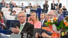 Jean-Claude Juncker and his team are released from the starting blocks as MEPs vote a resounding yes. A warm welcome from the big Groups, but anger from others.