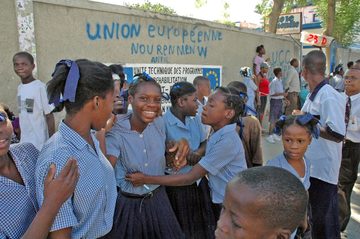 Pupils playing outside a school built with EU funds in Haiti