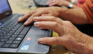 Pensioner is working with computer