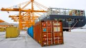 Image of goods containers and crains at the port