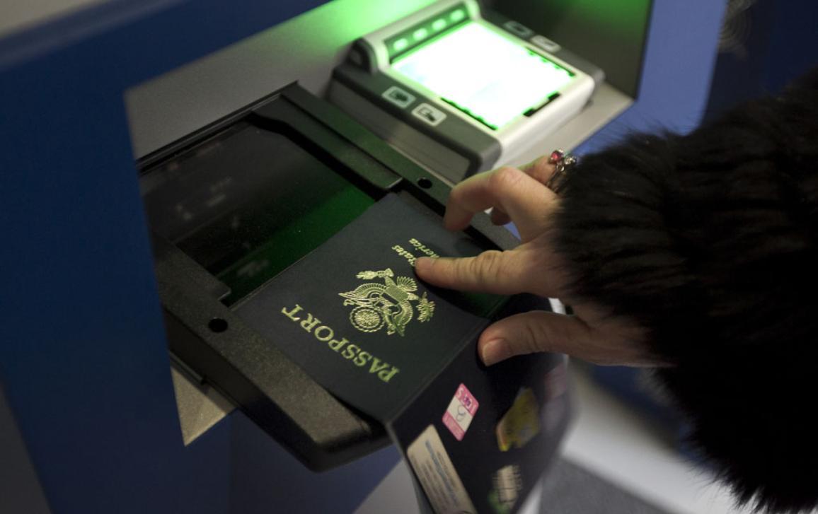 A passport been scanned at an airport border control ©BELGA_ZUMAPRESS