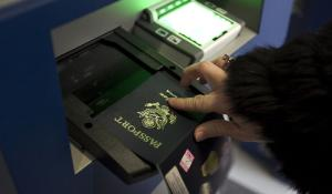 A passport been scanned at an airport border control ©BELGA_ZUMAPRESS