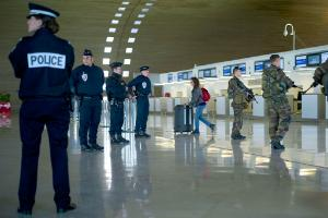 French soldiers and police patrol at the Charles de Gaulle airport on January 17, 2015 in Roissy-en-France, north of Paris, as part the Vigipirate plan, France's national security alert system