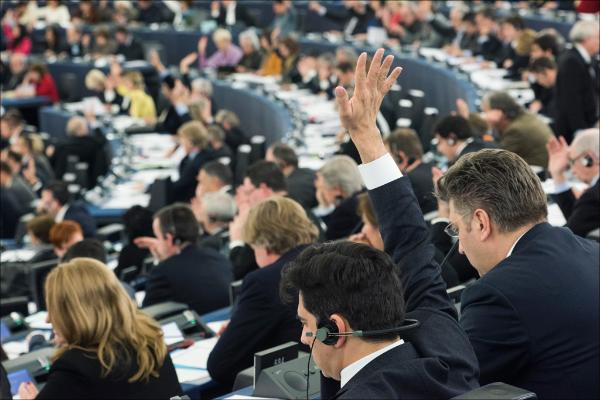 An MEP casts his vote on the European Parliament plenary chamber