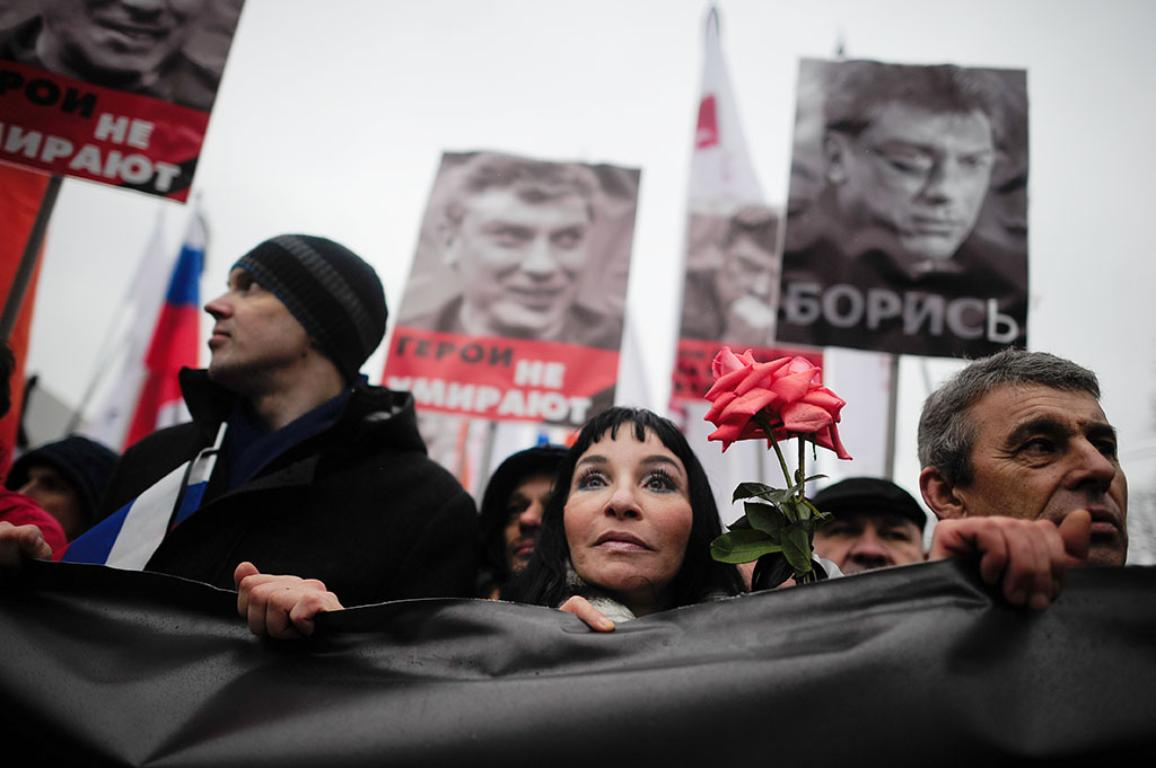 People march in memory of opposition leader Boris Nemtsov who was gunned down on Friday, Feb. 27, 2015 near the Kremlin