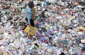 Chinese officials prepare to destroy over a million copies of faked DVDs seized in recent raids in Shenyang, China.©BELGA_AFP