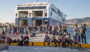 Refugees at the Mytilini harbour short time before they enter a ferry boat with the destination Athens-Piraeus