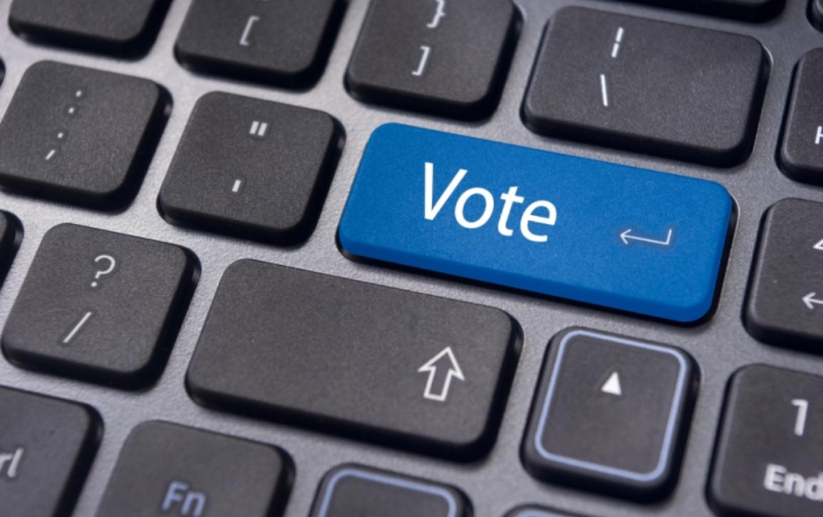 Image of a keyboard with one button written vote on it