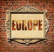 Placard on a brick wall with the word Europe