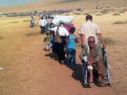 Syrian Kurdish refugees on their way into Turkey (September 2014) (c) European Union EC/ECHO