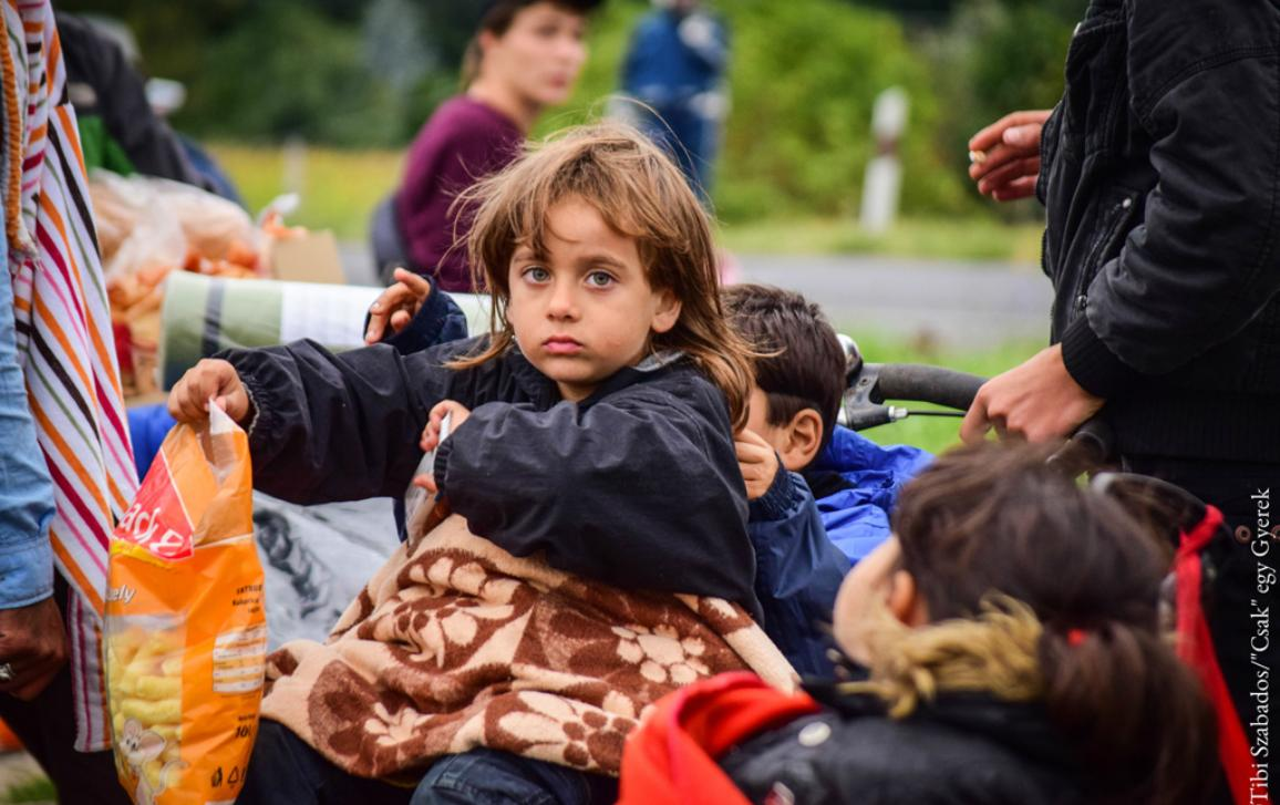 "150 refugees were on the way to Austria. I met them and I took this photo when they stopped for a break. ©Tibi Szabados/""Csak"" egy Gyerek (""Only"" a child)"
