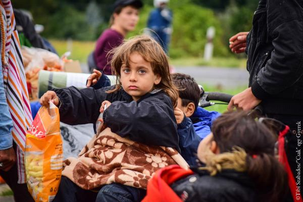 """150 refugees were on the way to Austria. I met them and I took this photo when they stopped for a break. ©Tibi Szabados/""""Csak"""" egy Gyerek (""""Only"""" a child)"""