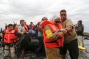 Migrants wearing safety jackets reach the Greek coast
