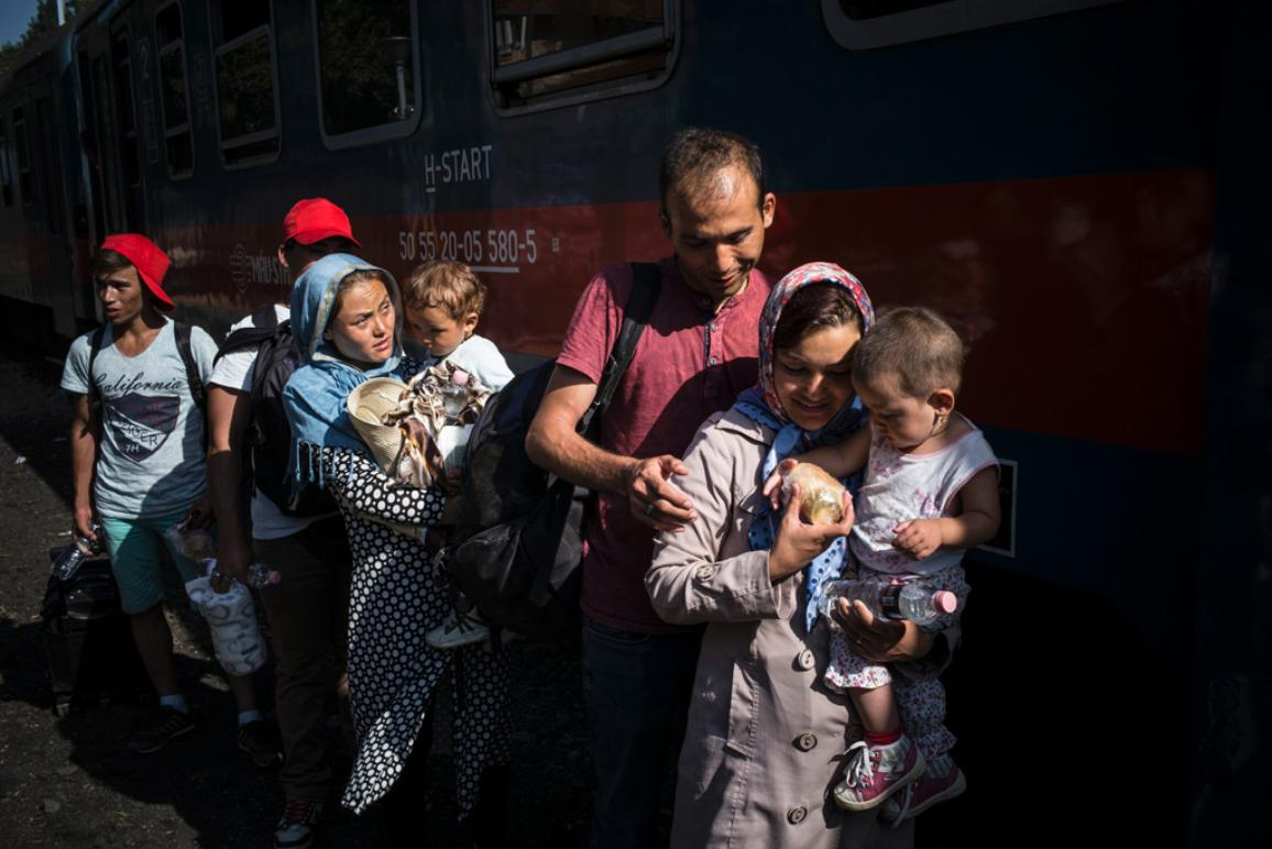 Refugees walk, at the Köszke's train station, Hungary, to take a train, chartered by the hungarian authorities, to go to the austrian border, on september 14, 2015. ©UNHCR/Olivier Laban-Mattei