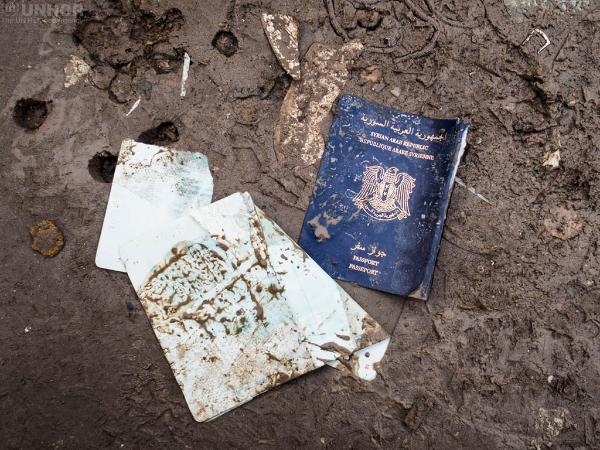 A torn Syrian passport seen on the Greek side of the border with the Former Yugoslav Republic of Macedonia, where more than 12000 refugees, mainly from Iraq and Syria, are waiting to cross and continue their journey towards Western Europe.  © UNHCR/Achilleas Zavallis