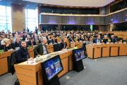 Image of EMIS committee meeting in European Parliament. People in a meeting room.