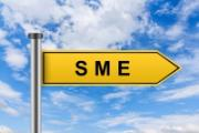 "Yellow flag or sign with word ""SME"" written on it. Background-blue sky with white clouds."
