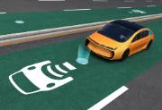 Yellow electric car on EV wireless charging lane, the in-road wireless charging coil have graphic to show charging progress