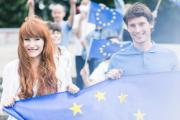 Picture of young community workers with European Union flags
