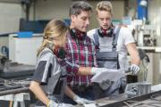 Young apprentices with professional metallurgist