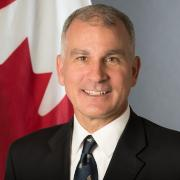 SEDE: portrait of Daniel J. Costello, Ambassador of Canada to the European Union in front of the Canadian flag