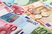 Different euro banknotes and coins.