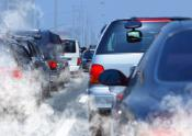 Cars stuck in traffic producing visible combustible gas emissions