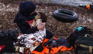 A mother and her baby rescued after crossing the sea in search of a safe live ©UNHCR/Achilleas Zavallis