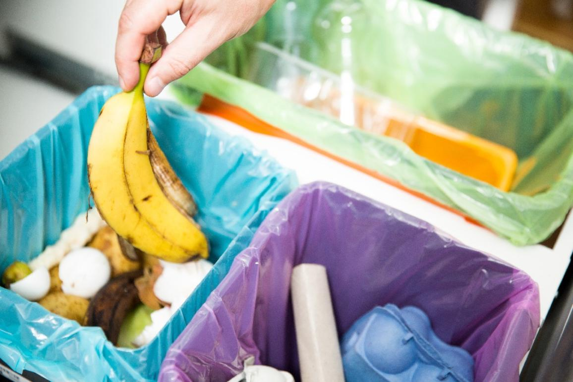 Woman putting banana peel in recycling bio bin in the kitchen. ©AP Images/European Union-EP
