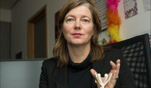 Portrait of Malin BJÖRK with a reproduction of a clitoridis in her hands