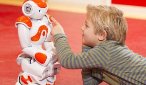 Child playing with robot