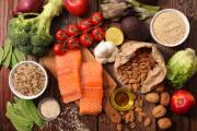 Selection of healthy food (salmon, tomatoes, broccoli, olive oil, nuts, almonds, rice, garlic and lemon