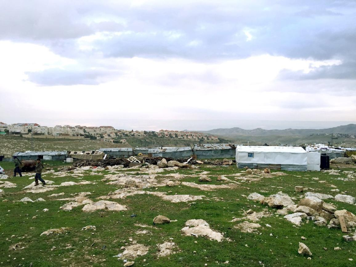 Palestinian Bedouin camp with Israeli settlement of Ma'ale Adumim in the background