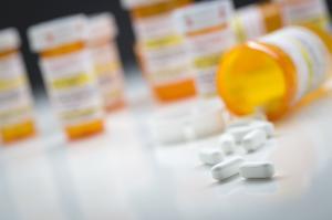 Medicine bottles behind pills ©AP Images/European Union-EP