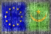 EU and Mauritania flags on concrete wall